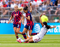 EAST HARTFORD, CT - JULY 5: Christen Press #11 of the USWNT is tackled during a game between Mexico and USWNT at Rentschler Field on July 5, 2021 in East Hartford, Connecticut.