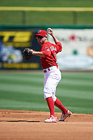 Clearwater Threshers second baseman Scott Kingery (31) throws to first during a game against the Charlotte Stone Crabs on April 13, 2016 at Bright House Field in Clearwater, Florida.  Charlotte defeated Clearwater 1-0.  (Mike Janes/Four Seam Images)
