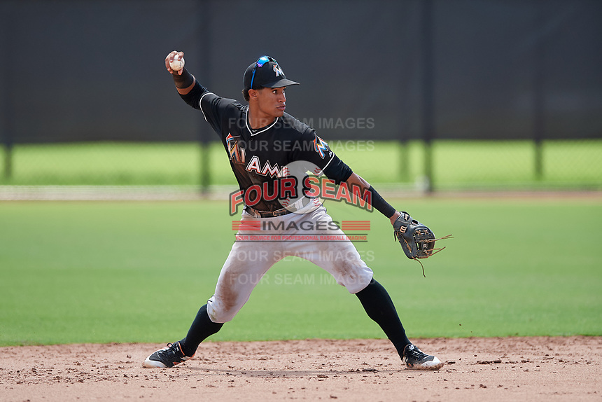 GCL Marlins second baseman Walner Espinal (14) throws to first base during a game against the GCL Astros on August 5, 2018 at FITTEAM Ballpark of the Palm Beaches in West Palm Beach, Florida.  GCL Astros defeated GCL Marlins 2-1.  (Mike Janes/Four Seam Images)