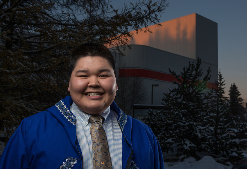 Small Business Administration Major Jalen Konukpeok has his photo taken in front of UAA's Fine Arts Building.