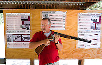 Photo story of Philmont Scout Ranch in Cimarron, New Mexico, taken during a Boy Scout Troop backpack trip in the summer of 2013. Photo is part of a comprehensive picture package which shows in-depth photography of a BSA Ventures crew on a trek.  In this photo an instructor  gives a safety demonstration on the proper usage of a shotgun being used by  BSA Venture Crews skeet shooting at the range in the backcountry at Philmont Scout Ranch.   <br /> <br /> The  Photo by travel photograph: PatrickschneiderPhoto.com