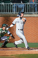 Brendon Sanger (23) of the Florida Atlantic Owls follows through on his swing against the Charlotte 49ers at Hayes Stadium on March 14, 2015 in Charlotte, North Carolina.  The Owls defeated the 49ers 8-3 in game one of a double header.  (Brian Westerholt/Four Seam Images)
