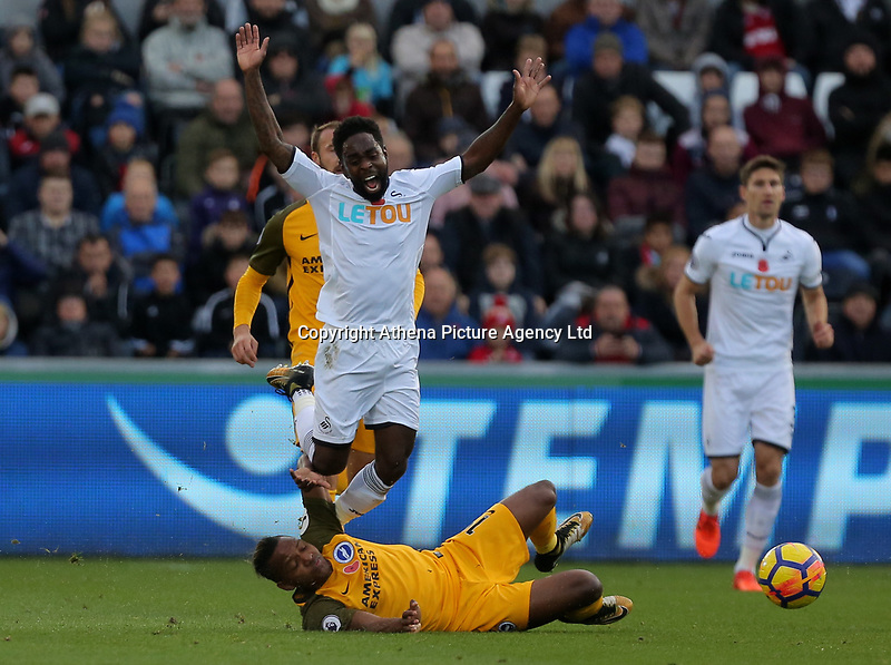 Nathan Dyer of Swansea City is fouled by Jose Izquierdo of Brighton during the Premier League match between Swansea City and Brighton and Hove Albion at The Liberty Stadium, Swansea, Wales, UK. Saturday 04 November 2017