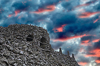 Dee Wright Observatory with sunrise clouds. McKenzie Pass. Oregon. Sky has been added. This is a Photo Illustration