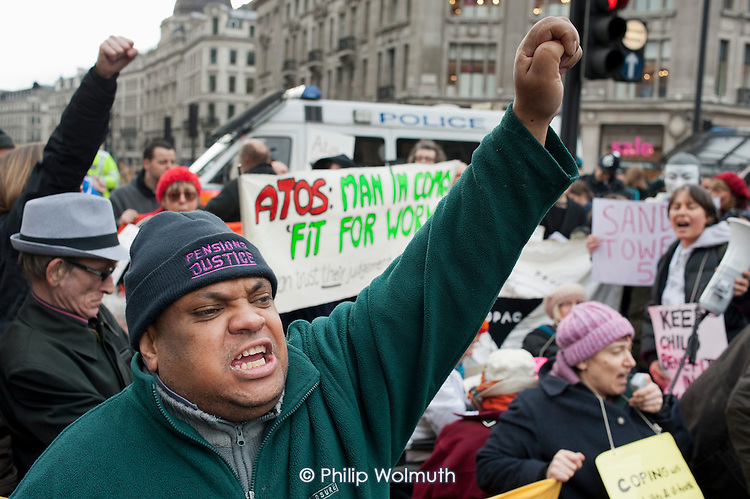 UK Uncut and Disabled People Against Cuts (DPAC) block the north side of Oxford Circus ein protest at the Welfare Reform Bill.