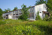 The abandoned dinning hall at Lyndonville Air Force Station on East Mountain in East Haven, Vermont. The US Air Force built the North Concord Radar Station on top of East Mountain in 1955. Its name was changed to Lyndonville Air force Station in 1962 and then closed in 1963. In 1961, the station supposedly reported a UFO sighting just a few hours before the reported abduction of Barney and Betty Hill on September 19-20, 1961.