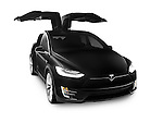 Black 2017 Tesla Model X luxury SUV electric car with open falcon wing doors isolated on white background Image © MaximImages, License at https://www.maximimages.com