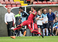 Simon Walton of Crawley Town stops Jason Banton of Wycombe Wanderers in his tracks during the Sky Bet League 2 match between Crawley Town and Wycombe Wanderers at Checkatrade.com Stadium, Crawley, England on 29 August 2015. Photo by Liam McAvoy.