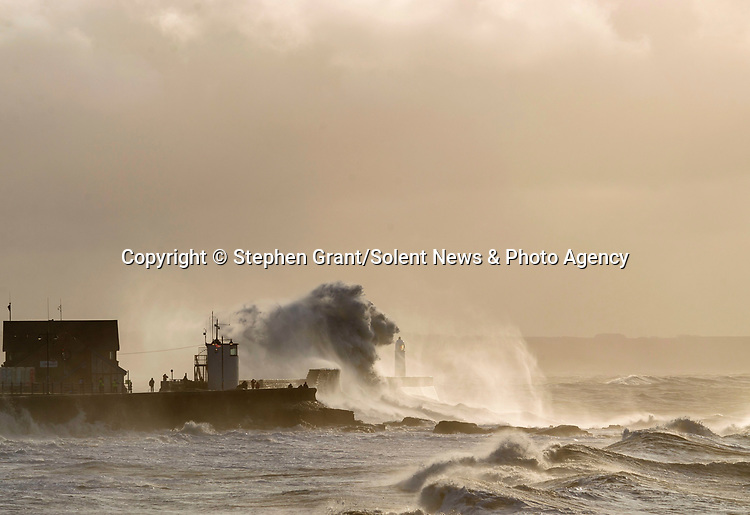 """Pictured:  The waves forming the shape of a lion<br /> <br /> A sea horse, wolf and lion appeared in blasts of spray as huge waves crash against a pier.  As the storm raged, giant walls of water battered the coastline and erupted in clouds above the pier, forming shapes of animals in the mist.<br /> <br /> Stephen Grant, 60, who lives in Porthcawl, Wales, with his wife Kath, caught all the images on the same morning in the seaside town.  He said: """"Storms occur throughout the year especially when the winds are blowing south-south westerly with gusts reaching up to 30mph to 40mph that cause big swells, throwing the waves over the pier, peaking at times to 20ft to 30ft high.  SEE OUR COPY FOR DETAILS.<br /> <br /> Please byline: Stephen Grant/Solent News<br /> <br /> © Stephen Grant/Solent News & Photo Agency<br /> UK +44 (0) 2380 458800"""