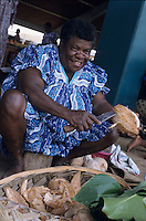 Smiling woman selling coconuts at the daily open market, Port Vila, Efate Island, Vanuatu.