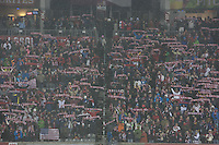 USA fans hold up scarves during the national anthem at Dick's Sporting Good Park in Commerce City, CO before the USA Men's National Team's World Cup Qualifier against Costa Rica on March 22, 2013.