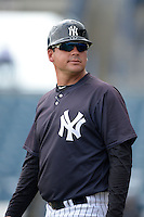 New York Yankees coach Mario Garza (26) during an Instructional League game against the Toronto Blue Jays on September 24, 2014 at George M. Steinbrenner Field in Tampa, Florida.  (Mike Janes/Four Seam Images)