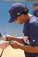 Catcher Erick San Pedro (5) of the Potomac Nationals, Class A Carolina League affiliate of the Washington Nationals, signs an autograph before a game on September 5, 2005, at Pfitzner Stadium in Woodbridge, Virginia. (Tom Priddy/Four Seam Images)