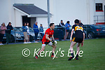 Glenbeigh/Glencar's Darran O'Sullivan looking for options to keep the attack going on Dr Crokes as Neil O'Shea closes the space.
