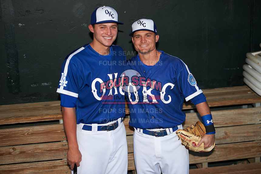 Oklahoma City Dodgers shortstop Corey Seager (18) and third baseman Buck Britton (4) pose for a photo in the dugout before a game against the Fresno Grizzles on June 1, 2015 at Chickasaw Bricktown Ballpark in Oklahoma City, Oklahoma.  Fresno defeated Oklahoma City 14-1.  (Mike Janes/Four Seam Images)