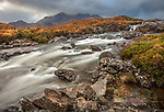Isle of Skye, Scotland: Rushing waters of the River Sligachan with breaking light on the Black Cuillin Mountains in the distance