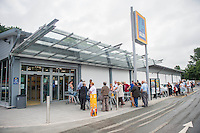 Thursday  21 July 2016<br /> Pictured: Around 30-40 Customers wait for the store to open Re: ALDI Haverfordwest Grand Re-opening
