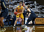 SIOUX FALLS, SD - MARCH 9: Rocky Kreuser #34 of the North Dakota State Bison looks to make a move against Francis Lacis #22 of the Oral Roberts Golden Eagles during the 2021 Men's Summit League Basketball Championship at the Sanford Pentagon in Sioux Falls, SD. (Photo by Dave Eggen/Inertia)