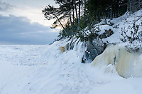 The rugged, natural beauty of the Lake Superior shoreline frozen in time. Marquette, MI