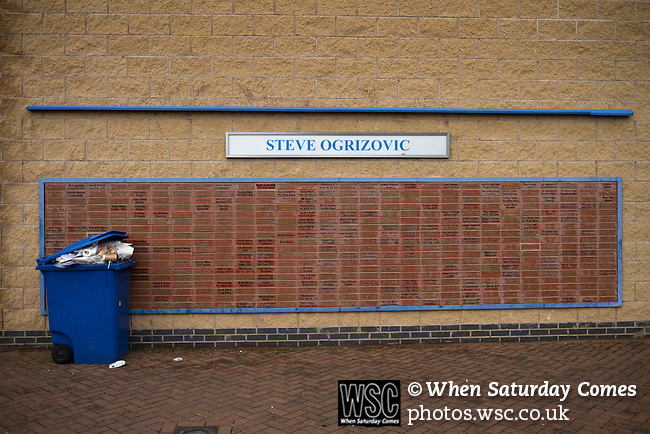 Coventry City 1 Birmingham City 1, 10/03/2012. Ricoh Arena, Championship. An overflowing rubbish bin next to a 'Wall of Fame' dedicated to former home goalkeeper Steve Ogrizovic outside the Ricoh Arena, pictured before Coventry City hosted Birmingham City in an Npower Championship fixture. The match ended in a one-all draw, watched by a crowd of 22,240. The Championship was the division below the top level of English football. Photo by Colin McPherson.
