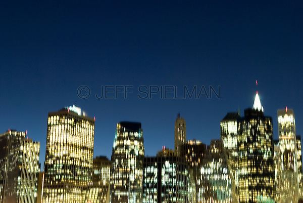 AVAILABLE FROM JEFF AS A FINE ART PRINT.<br /> <br /> AVAILABLE FOR LICENSING FROM PLAINPICTURE.  Please go to www.plainpicture.com and search for image # p5690232.<br /> <br /> Lower Manhattan Financial District Skyline at Dusk - Blurred Motion, New York City, New York State, USA