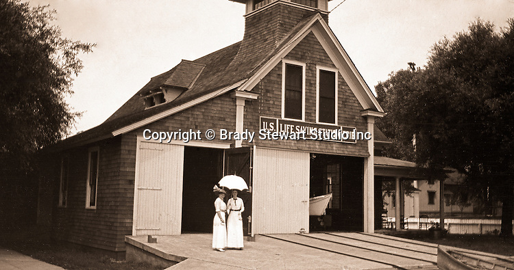 Erie PA: View of Lake Erie Life Saving Station.  Sarah Stewart and her sister posing in front of the Life Saving Station.