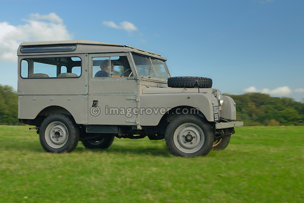 Very original historic 1950s Landrover Series 1 88in Station Wagon of the Dunsfold Collection driven by Philip Bashall across a field in Dunsfold, Surrey, south England. Europe, UK, England, Surrey, Dunsfold. --- RIGHTS PROTECTION AVAILABLE ON REQUEST. Automotive trademarks are the property of the trademark holder, authorization may be needed for some uses.