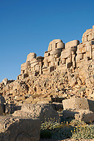 Headless seated statues in front of the stone pyramid 62 BC Royal Tomb of King Antiochus I Theos of Commagene, east Terrace, Mount Nemrut or Nemrud Dagi summit, near Adıyaman, Turkey