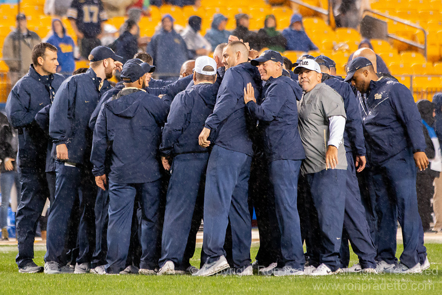The Pitt football coaches huddle before the game. The Penn State Nittany Lions defeated the Pitt Panthers 51-6 on September 08, 2018 at Heinz Field in Pittsburgh, Pennsylvania.