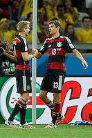 Andre Schurrle of Germany celebrates scoring a goal with Thomas Muller after making it 0-6