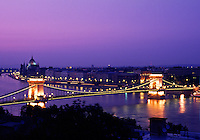 The Budapest skyline at night with a view of the Parliament building and Chain Bridge spanning the Danube River. Hungary.