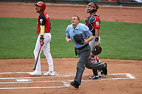 Team USA batter J.P. Crawford (3), World Team catcher Gary Sanchez, and umpire Ron Teague track a fly ball during the MLB All-Star Futures Game on July 12, 2015 at Great American Ball Park in Cincinnati, Ohio.  (Mike Janes/Four Seam Images)