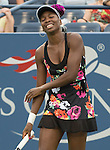Venus Williams (USA) battles against Jie Zheng (CHN) at the US Open being played at USTA Billie Jean King National Tennis Center in Flushing, NY on August 28, 2013