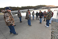 GATHERING OF ANGLERS<br />Dave Kirgan (left), president of the Dirty 20 fishing club, gets members ready to hit the water at dawn on Tuesday Oct. 13 2020 at Prairie Creek park. The club fishes for black bass most Tuesday mornings at Beaver Lake. Members pony up a few dollars each week to fund a modest prize for the largest black bass and the heaviest stringer. The club is one of the longest running fishing groups at Beaver. Go to nwaonline.com/201014Daily/ to see more photos.<br />(NWA Democrat-Gazette/Flip Putthoff)
