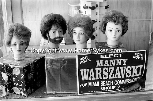 Local election poster hair dressers shop window. South Beach Miami, Florida 1999 .