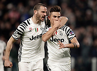Juventus' Paulo Dybala, left, celebrates with his teammate Leonardo Bonucci after scoring on a penalty kick during the Champions League round of 16 soccer match against Porto at Turin's Juventus Stadium, 14 March 2017.<br /> UPDATE IMAGES PRESS/Isabella Bonotto
