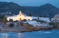 Seaside restaurant and the cemetery in the evening. Sitges, Catalonia, Spain