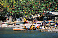 Fishermen & boats in village of Scots Head, island of Dominica , West Indies. Scots Head Village, Dominica West Indies.