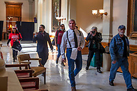 """Chester Doles, center, leader of American Patriots USA, roams the third floor of the Georgia State Capitol building looking for the office of Georgia Secretary of State Brad Raffensperger, Wednesday, Jan. 6, 2021, in Atlanta. Doles made remarks at a """"Stop the Steal"""" rally outside of the building before attempting to speak with Raffensperger. Raffensperger was walked out of the building surrounded by officers as Doles made his way inside. (Alyssa Pointer/Atlanta Journal-Constitution via AP)"""