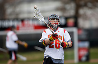 John Haus (26) of Maryland looks for a pass while playing Penn at Ludwig Field in College Park, Maryland.
