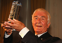 The winner of the 2008 Charles Taylor Prize for Literary Non-Fiction, Richard Gwyn, holds the prize trophy high at today's award ceremony in Toronto at the King Edward Hotel.  Richard won the $25,000 prize for his book The Man Who Made Us; The Life and Times of John A Macdonald. (CNW Group/Charles Taylor Prize for Literary Non-Fiction)