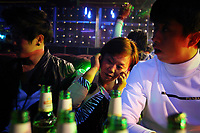 China. Jilin Province. Young people in a nightclub in the town of Yanji, close to the border with North Korea. The town is part of the Korean Autonomous Prefecture in the north-east of the country. 2011