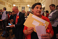 Pictured: Labour candidate for Gower constituency Tonia Antoniazzi clutches the official results handed over by the returning officer after her win was announced.  Friday 09 June 2017<br />
