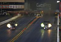 Jul. 25, 2014; Sonoma, CA, USA; NHRA top fuel driver Bob Vandergriff Jr (right) races alongside J.R. Todd during qualifying for the Sonoma Nationals at Sonoma Raceway. Mandatory Credit: Mark J. Rebilas-