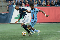 FOXBOROUGH, MA - SEPTEMBER 29: Sebastien Ibeagha #33 of New York City FC tackles Teal Bunbury #10 of New England Revolution near the New York goal during a game between New York City FC and New England Revolution at Gillettes Stadium on September 29, 2019 in Foxborough, Massachusetts.