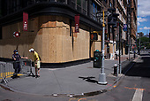 New York New York<br /> June 7, 2020<br /> <br /> After several nights of looting, nearly all ground level windows in Manhattan are covered with plywood. Many of the shops had already been looted others are boarded for protection. <br /> <br /> Streets with police stations are cordoned in fear of attack.
