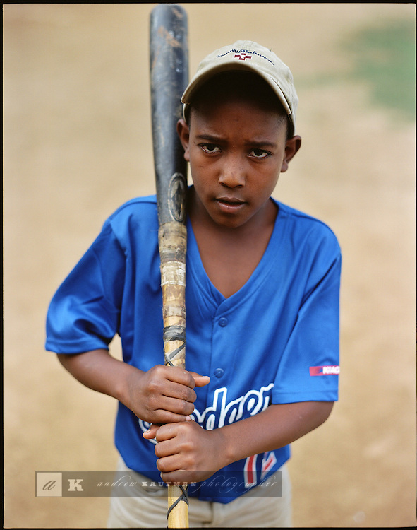 At the Estadio Olimpico young major league baseball hopefuls workout playing baseball all day long. Some of the hopefuls play for the Luca Y Chaca baseball academy. Their equipment has seen better days.