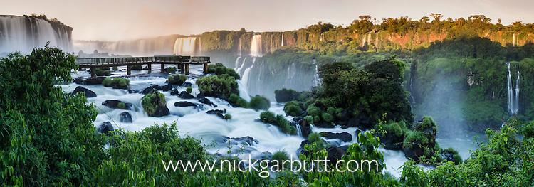Iguasu Falls at sunrise (also Iguazu Falls, Iguazú Falls, Iguassu Falls or Iguaçu Falls) on the Iguasu River, Brazil / Argentina border. Photographed from the Brazilian side of the Falls. State of Paraná, Brasil.