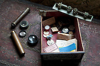 A collection of Victorian artefacts, including telescope lenses, tickets, medals, and a small model of some battlements made of card