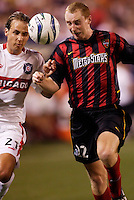 The Chicago Fire's Justin Mapp goes for the ball with MetroStars' Tim Regan. The Chicago Fire played the NY/NJ MetroStars to a one all tie at Giant's Stadium, East Rutherford, NJ, on May 15, 2004.